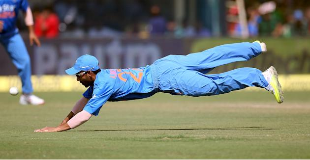 India's Rahane dives to stop the ball during their first one-day international cricket match against South Africa in Kanpur
