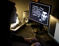 A masked hacker, part of the Anonymous group, pictured in Lyon, France in January 2012. A man linked to notorious hacker collective Anonymous was charged on Monday with cyber attacks on police websites in the US state of Utah