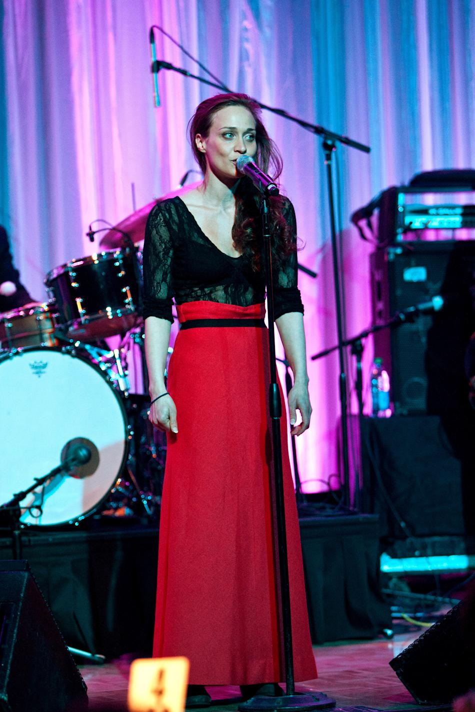 Fiona arrived back on the radar with a performance last February in Beverley Hills wearing a sexy lace top tucked into a belted floor-length crimson skirt, haunting and beautiful as ever. (Michael Bez