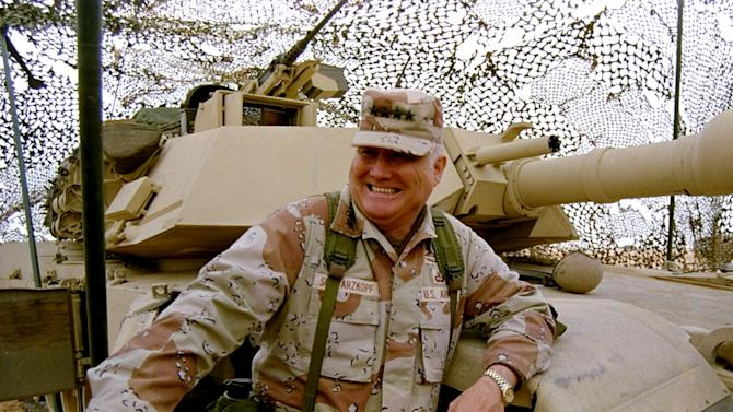 FILE - In this Jan. 12, 1991 file photo, Gen. H. Norman Schwarzkopf stands at ease with his tank troops during Operation Desert Storm in Saudi Arabia. Schwarzkopf died Thursday, Dec. 27, 2012 in Tampa, Fla. He was 78.  (AP Photo/Bob Daugherty, File)