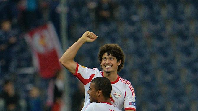 Salzburg's Alan ,  from left, and Andre Ramalho celebrate after scoring  during the Europa League group C soccer match  between Red  Bull Salzburg and Standard  Liege  in Salzburg, Austria, Thursday, Oct.  24, 2013