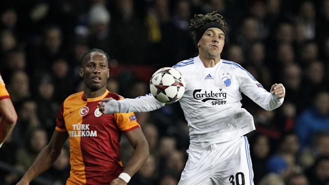 Galatasaray's Didier Drogba, left, and FC Copenhagen's Christian Bolanos of Costa Rica compete for the ball during their Champions League Group B soccer match at Parken Stadium, Copenhagen, Denmark, Tuesday Nov. 5, 2013