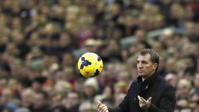 Liverpool manager Rodgers throws the ball back onto the pitch during their English Premier League soccer match against Hull City in Liverpool