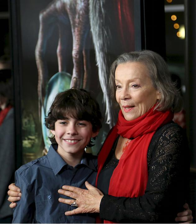Actors Emjay Anthony (L) and Krista Stadler attend the industry premiere of the film Krampus in Los Angeles, California.