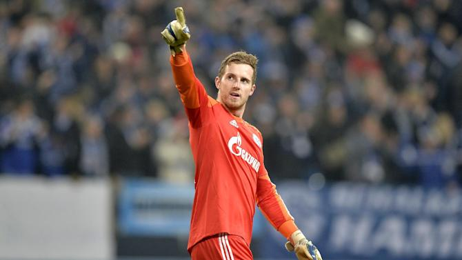 Schalke goalkeeper Ralf Faehrmann points after the Champions League Group E soccer match between FC Schalke 04 and FC Basel in Gelsenkirchen, Germany, Wednesday, Dec. 11, 2013. Schalke defeated Basel by 2-0