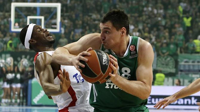 Panathinaikos' Jonas Maciulis, right, goes to score as Olympiakos' Brent Petway defends during their Euroleague basketball match of Top 16 at the Olympic Indoor Arena in Athens, Thursday, Feb. 20, 2014