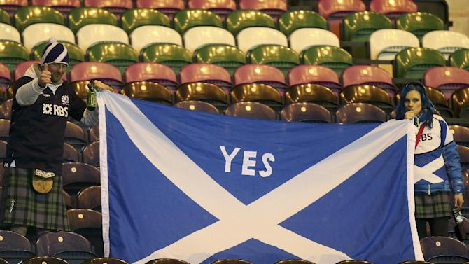 Scottish rugby fans hold a Saltire flag at the end of the Six Nations rugby union international match between Scotland and France at Murrayfield in Edinburgh, Scotland, Saturday March 8, 2014