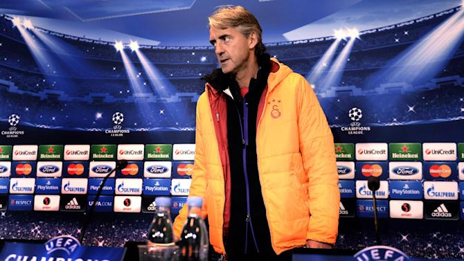 Galatasaray AS's coach, Roberto Mancini during a press conference prior to the Champions League soccer match against FC Copenhagen at Parken Stadium in Copenhagen, Denmark, Monday, Nov. 4, 2013