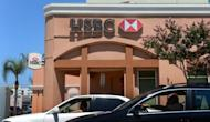 Drivers pass a branch of HSBC bank in Alhambra, east of downtown Los Angeles. Shares in global banking giant HSBC fell more than two percent in Hong Kong on Wednesday after a top executive resigned over the lender's failure to control money laundering and terrorist financing