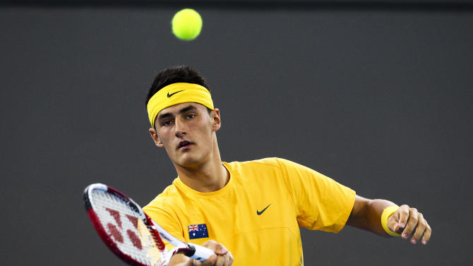 Bernard Tomic of Australia hits the ball against Cho Min-Hyeok of South Korea during their men's singles Davis Cup tennis match in Brisbane on April 6, 2012. Australia take on South Korea in the Asia-Oceania group second-round tie. AFP PHOTO/Patrick HAMILTON (Photo credit should read PATRICK HAMILTON/AFP/Getty Images)