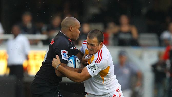 New Zealand Waikato Chiefs' JPO Pietersen (L) vies with Durban Sharks' Richard Kahui during a Super 15 rugby union match at the Mr Price Kings Park Rugby Stadium on April 21, 2012.  AFP PHOTO (Photo credit should read -/AFP/Getty Images)