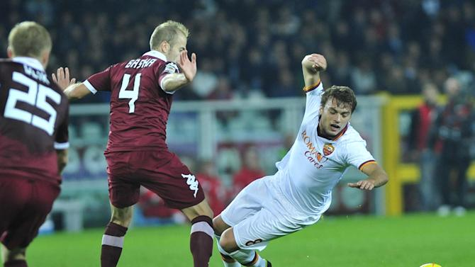 AS Roma forward Adem Liajic, of Serbia, right, vies for the ball with F.C. Torino defender Migjen Basha, of Switzerland, during their Serie A soccer match at Turin's Olympic stadium, Italy, Sunday, Nov. 3, 2013
