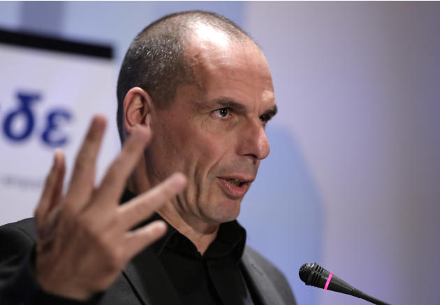 Greek Finance Minister Yanis Varoufakis gives a speech during a banking conference in Athens, on Tuesday, April 21, 2015. Greek local authorities were on the brink of revolt Tuesday against the centra