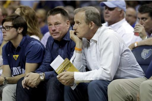 Tennessee head football coach Butch Jones, center, and head basketball coach Rick Barnes, right, watch the first half of Game 4 of a second-round NBA basketball Western Conference playoff series between the Memphis Grizzlies and the Golden State Warriors, Monday, May 11, 2015, in Memphis, Tenn. (AP Photo/Mark Humphrey)