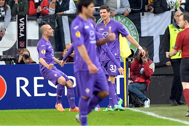 Fiorentina forward Mario Gomez, right, celebrates with teammate Borja Valero after scoring, during an Europa League, round of 16, soccer match between Juventus and Fiorentina at the Juventus stadium,