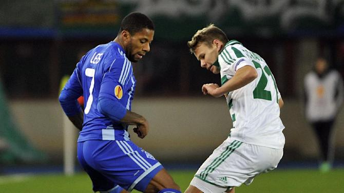 Rapid's Louis Schaub, right, and Kiev's Jeremain Lens challenge for the ball, during their Europa League second round group G soccer match between SK Rapid Wien and FC Dynamo Kiev, in Vienna, Austria, Thursday, Oct. 3, 2013