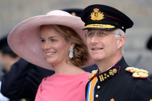Prince Philippe of Belgium and his wife Princess Mathilde leave the Nieuwe Kerk (New Church) in Amsterdam on April 30, 2013 after attending the investiture of King Willem-Alexander of the Netherlands.