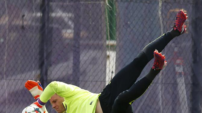 Barcelona's goalkeeper ter Stegen catches a ball during a training session at Ciutat Esportiva Joan Gamper in Sant Joan Despi near Barcelona