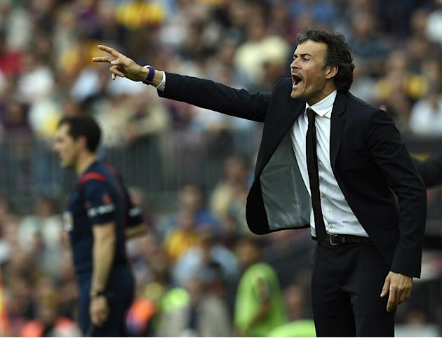 Barcelona's coach Luis Enrique shouts during the Spanish league football match FC Barcelona v Valencia CF at the Camp Nou stadium in Barcelona on April 18, 2015