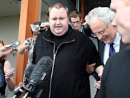 Megaupload boss Kim Dotcom leaves court after he was granted bail in the North Shore court in Auckland on February 22. Dotcom's extradition case against US authorities has been delayed until next year amid legal wrangling in New Zealand over evidence disclosure, his lawyers said Tuesday
