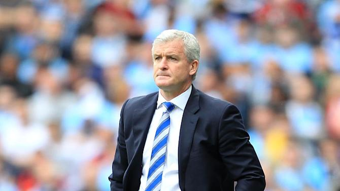 Mark Hughes, pictured, insists he still has the full support of Tony Fernandes