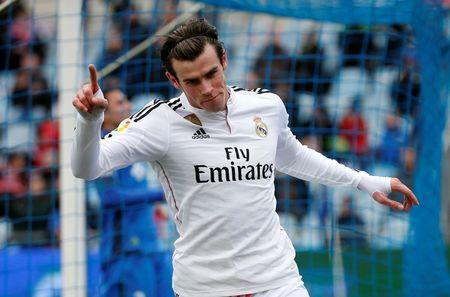 Real Madrid's Bale celebrates after scoring a goal against Getafe during their Spanish first division soccer match in Getafe