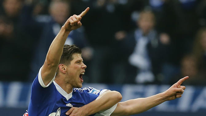 Schalke's Klaas-Jan Huntelaar of the Netherlands, front, and Schalke's Kaan Ayhan of Turkey celebrate after scoring during the German first division Bundesliga soccer match between Schalke 04 and Eintracht Braunschweig in Gelsenkirchen , Germany, Saturday, March 22, 2014
