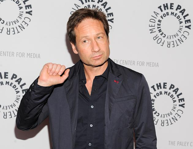 """FILE - In this Oct. 12, 2013 file photo, actor David Duchovny attends """"The Truth Is Here: David Duchovny and Gillian Anderson on The X-Files"""" at The Paley Center for Media in New York. Ducho"""