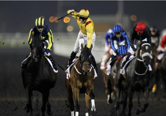 "Mullen, riding Reynaldothewizard of the U.S., reacts as he crosses the finish line during the sixth race ""Dubai Golden Shaheen"" of the Dubai World Cup at the Meydan Racecourse in Dubai"