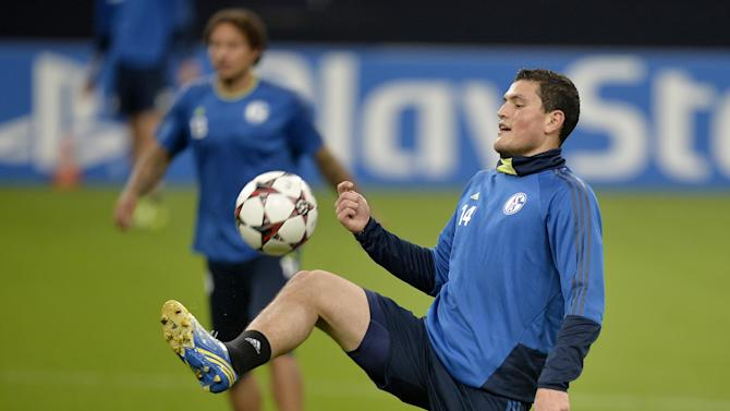 Schalke's Kyriakos Papadopoulos of Greece exercises during a training session prior the Champions League Group E soccer match between FC Schalke 04 and FC Chelsea in Gelsenkirchen, Germany, Monday, Oct. 21, 2013