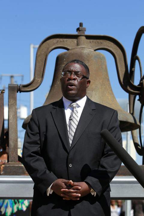 Pastor Arthur Price speaks prior to the ringing of the bell and placing of the wreath outside 16th Street Baptist Church in Birmingham