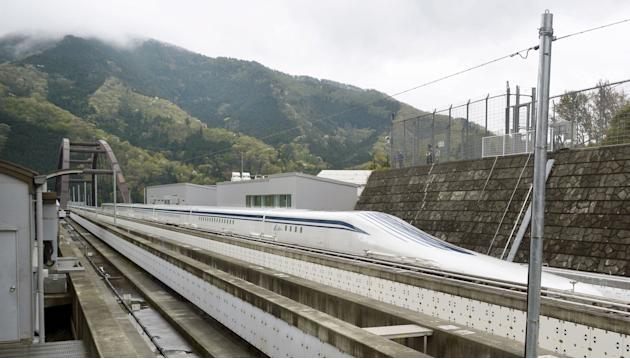 A magnetically levitating train operated by Central Japan Railway Co. making a test run is seen on an experimental track in Tsuru, Yamanashi Prefecture