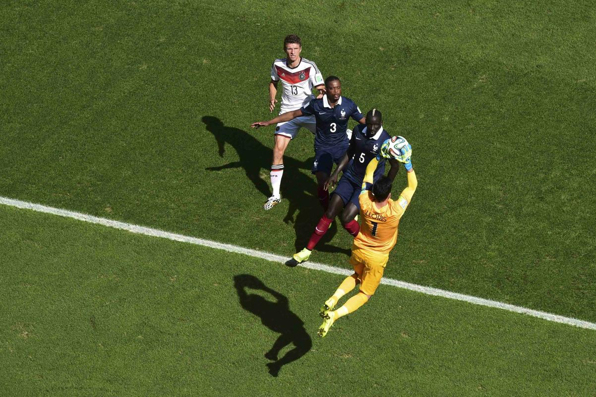 France's Lloris makes a save in front of Sakho, Evra and Germany's Mueller during their 2014 World Cup quarter-finals at the Maracana stadium ...