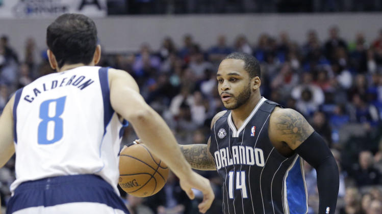 Ellis, Nowitzki help Mavs cruise past Magic 107-88