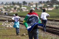 A man walks away from the main road after the funeral cortege of former South African President Nelson Mandela passed through Mthatha, December 14, 2013. REUTERS/Rogan Ward