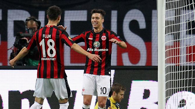Frankfurt's Vaclav Kadlec of Czech Republic, center, celebrates his side's opening goal during a Europa League group F match between Eintracht Frankfurt and Maccabi Tel Aviv in Frankfurt, Thursday, Oct.24, 2013