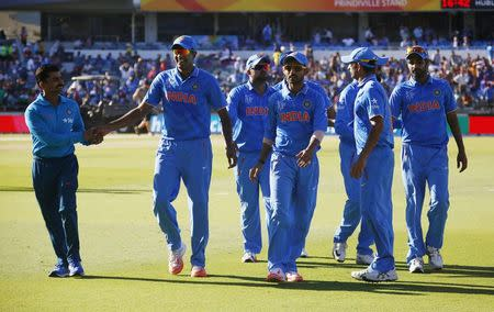 Members of India's World Cup cricket team leave the field after dismissing the UAE for just 102 runs, the lowest score against India in world cups, at the Cricket World Cup in Perth
