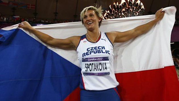 Czech Republic's Barbora Spotakova celebrates with her national flag after winning the gold medal in the women's javelin throw final at the London 2012 Olympic Games at the Olympic Stadium (Reuters)