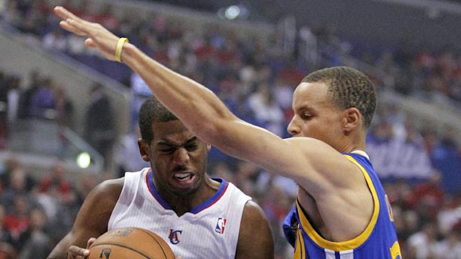 Los Angeles Clippers guard Chris Paul, left, bumps into Golden State Warriors guard Stephen Curry while going up for a shot in the first quarter during an NBA basketball game on Thursday, Oct. 31, 2013, in Los Angeles