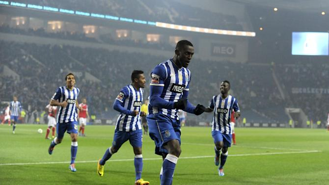 FC Porto's Jackson Martinez, from Colombia, celebrates with teammates after scoring the opening goal against Sporting Braga in a Portuguese League soccer match at the Dragao Stadium in Porto, Portugal, Saturday, Dec. 7, 2013