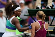 Serena Williams shakes hands with Dominika Cibulkova after beating the Slovakian on March 25, 2013. Williams struggled, having to come from a set down to win 2-6, 6-4, 6-2