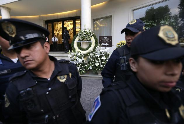 Police officers block entrance to funeral home where body of Colombian Nobel Prize laureate Garcia Marquez was taken to, in Mexico City