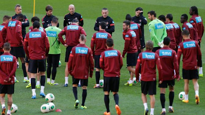 Portugal's coach Paulo Bento, background center, gathers the players for a training session Sunday, Nov. 17 2013, at the Luz stadium in Lisbon. Portugal will play Sweden on Tuesday in a World Cup qualifying playoff second-leg soccer match