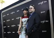 """Director Guillermo del Toro and his wife Lorenza pose at the premiere of """"Pacific Rim"""" at Dolby theatre in Hollywood, California July 9, 2013. The movie opens in the U.S. on July 12. REUTERS/Mario Anzuoni"""