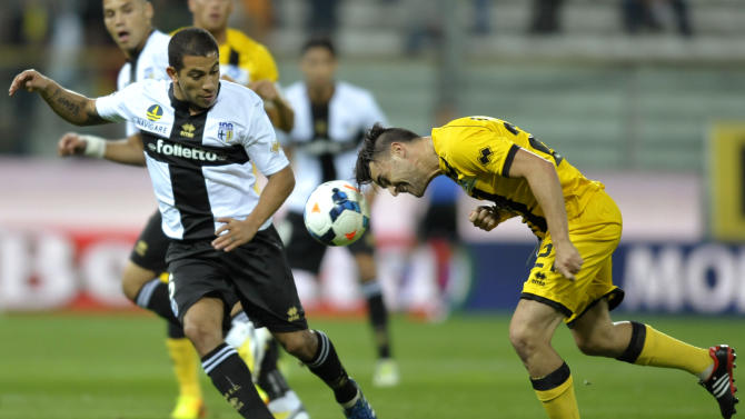 Parma's Walter Gargano of Uruguay, left, vies for the ball with Atalanta's Luca Cigarini, during their Serie A soccer match at Parma's Tardini stadium, Italy, Wednesday, Sept. 25, 2013