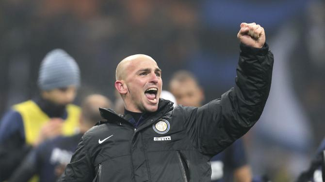 Inter Milan Argentine midfielder Esteban Cambiasso celebrates after winning the Serie A soccer match between Inter Milan and AC Milan at the San Siro stadium in Milan, Italy, Sunday, Dec. 22, 2013. A late goal from Rodrigo Palacio gave Inter Milan a 1-0 win over city rival AC Milan in an entertaining derby match in Serie A on Sunday. Palacio struck four minutes from time to send three quarters of San Siro into a frenzy