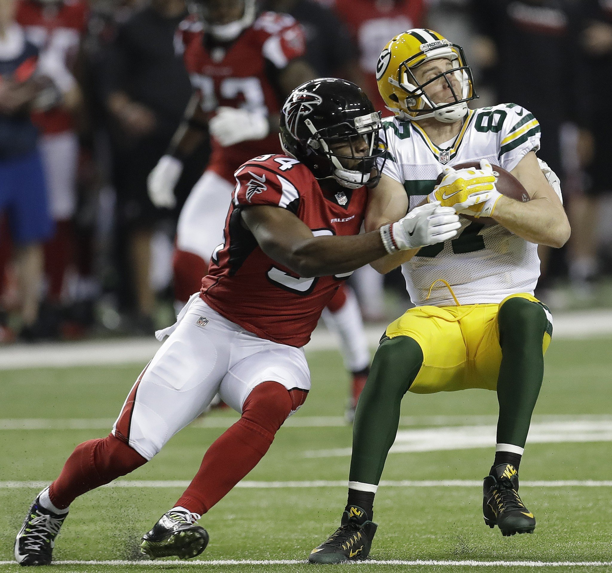 Jordy Nelson is heavily padded to protect his fractured ribs against the Atlanta Falcons. (AP)
