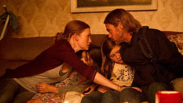"This publicity image released by Paramount Pictures shows, from left, Mireille Enos as Karin Lane, Sterling Jerins as Constance Lane, Abigail Hargrove as Rachel Lane, and Brad Pitt as Gerry Lane in a scene from ""World War Z."" (AP Photo/Paramount Pictures, Jaap Buitendijk)"