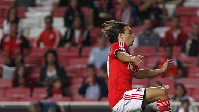 Benfica's Lazar Markovic, jumps next to Anderlecht's goalkeeper Silvio Proto during the Champions League group C soccer match between Benfica and Anderlecht Tuesday, Sept. 17, 2013, at Benfica's Luz stadium in Lisbon