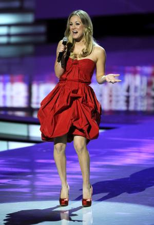 Host Kaley Cuoco is seen onstage during the People's Choice Awards on Wednesday, Jan. 11, 2012 in Los Angeles. (AP Photo/Chris Pizzello)